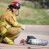 A firefighter monitors air pressure for a pneumatic drill at CSFD Headquarters in Colorado Springs, Colo. on Friday, Sept. 22, 2017. The drill was being used to access a damaged tanker as part of the Hazardous Materials Team's highway emergency response training.<br /> <br /> (The Gazette, Nadav Soroker)