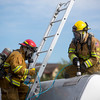 Colorado Springs firefighters drill an access hole into a practice tanker at CSFD Headquarters in Colorado Springs, Colo. on Friday, Sept. 22, 2017. The exercise was part of a highway emergency hazardous materials response training.<br /> <br /> (The Gazette, Nadav Soroker)