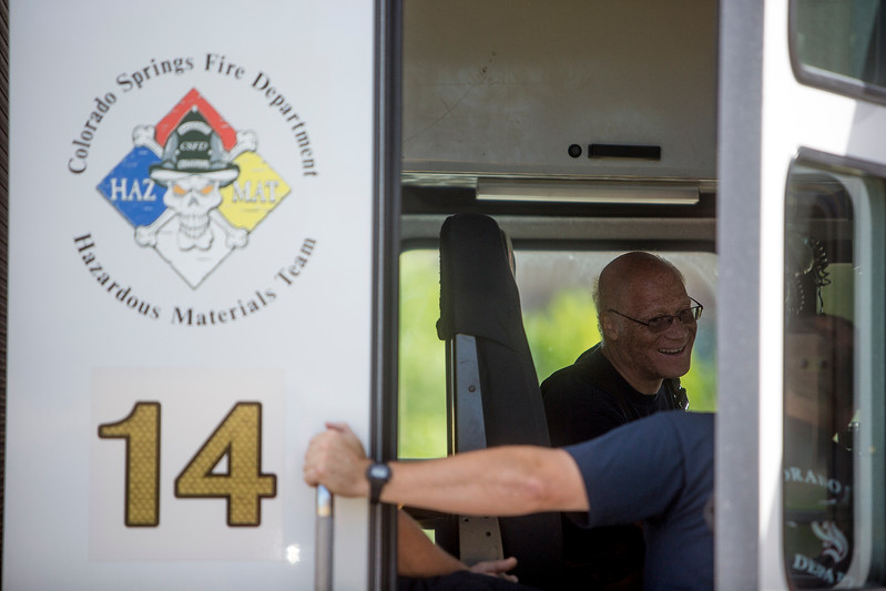 Bob Dodd laughs with a fellow firefighter at Hazardous Materials training at CSFD Headquarters in Colorado Springs, Colo. on Friday, Sept. 22, 2017. Dodd was practicing with a command center in the truck that allows firefighters to access information about materials and track how they might spread.<br /> <br /> (The Gazette, Nadav Soroker)