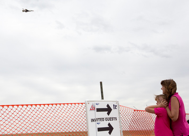Nicole Cichon, 12, covers her ears with her mother's help as one of the Thunderbird's F-16s passes by at the High Flight day at the Pikes Peak Regional Airshow, on Friday, Sept. 22, 2017. High Flight was held during the practice day before the airshow started and allowed children with special needs to come when the area wouldn't be crowded.<br /> <br /> (The Gazette, Nadav Soroker)