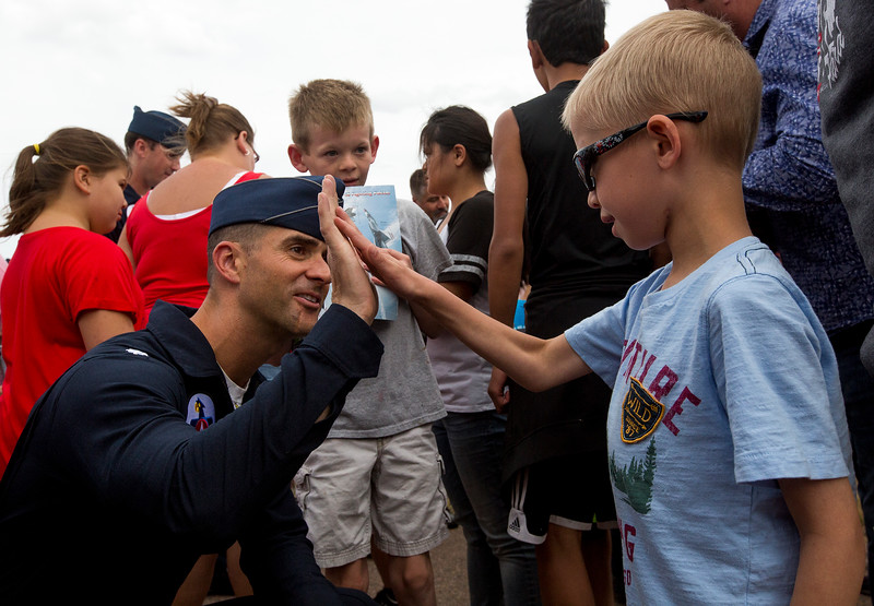 Blaze Beiermann, 8, high-fives Lt. Col. Jason Heard, the team commander, during a meet and greet at the High Flight day at Pikes Peak Regional Airshow on Friday, Sept. 22, 2017. Children with special needs from around the Pike's Peak region were invited to the practice day along with their families.<br /> <br /> (The Gazette, Nadav Soroker)