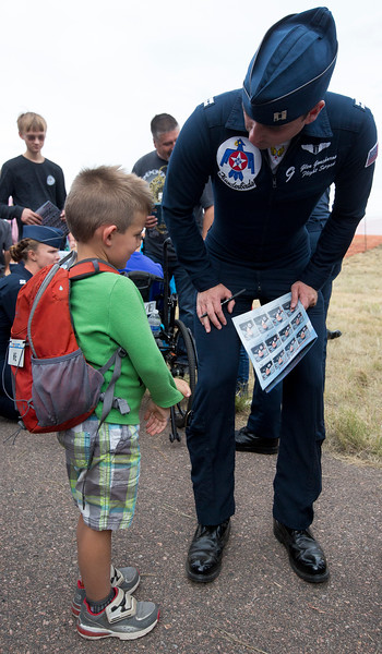 Theo Herndon, 5, gets a signature on his team roster by Capt. Glen Goncharow at the High Flight day at the  Pikes Peak Regional Airshow on Friday, Sept. 22, 2017. About 400 people attended the event, near the maximum that the organizers wanted.<br /> <br /> (The Gazette, Nadav Soroker)