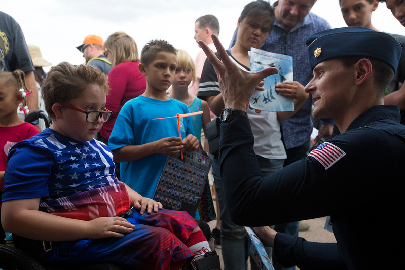 Maj. Ryan Bodenheimer asks Jacob Jordan, 8, what he thought of the Thunderbirds' performance during the practice session the day before the Pikes Peak Regional Airshow on Friday, Sept. 22, 2017. Jordan gave the pilots' performance an 'A' rating.<br /> <br /> (The Gazette, Nadav Soroker)