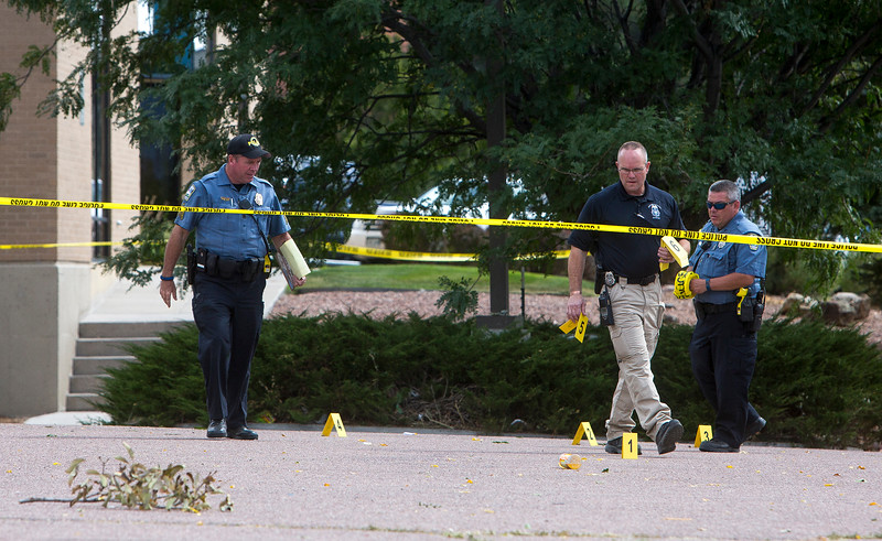 Police mark evidence in the parking lot where a student was shot in Colorado Springs, Colo. on Friday, Sept. 22, 2017. Doherty High School was secured for the rest of the day.<br /> (The Gazette, Nadav Soroker)
