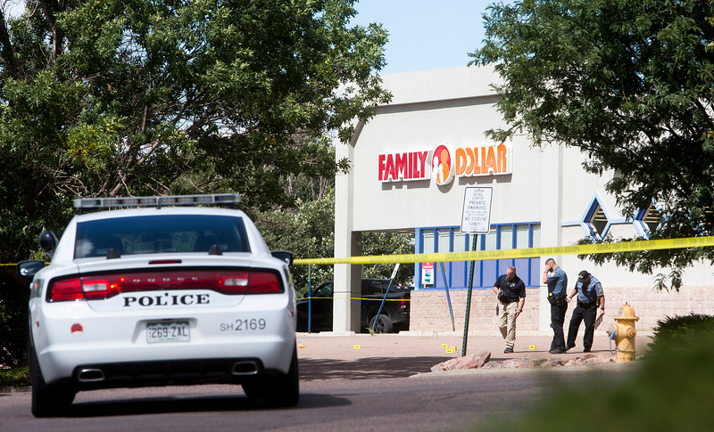 Colorado Springs Police mark evidence from a shooting in the parking lot across the street from Doherty High School in Colorado Springs, Colo. on Friday, Sept. 22, 2017. The shooting happened while students were on lunch break across the street.<br /> <br /> (The Gazette, Nadav Soroker)