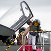 Tiegen Cox, 7, climbs out of a display cockpit at the Pikes Peak Regional Airshow on Saturday, Sept. 23, 2017. Tiegen got help from his dad, Ron Cox.<br /> (The Gazette, Nadav Soroker)