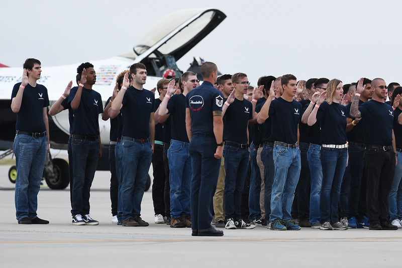Enlistees speak their oath of enlistment on the hot deck at the Pikes Peak Regional Airshow on Saturday, Sept. 23, 2017. Their oath was administered by Lt. Col. Jason Heard, the commander of the Thunderbirds.<br /> <br /> (The Gazette, Nadav Soroker)