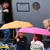 Rick Duhaime climbs out of the C-130 as Michael, 8, and Rachel, 6, wait with umbrellas and their mother, Laura at the Pikes Peak Regional Airshow on Saturday, Sept. 23, 2017. Several demonstrations were canceled due to rain.<br /> (The Gazette, Nadav Soroker)