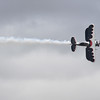 """Kyle Franklin cruises past the crowd in his custom bi-plane """"Dracula"""" during an aerobatics demonstration at the Pikes Peak Regional Airshow on Saturday, Sept. 23, 2017. Dracula is styled similarly to a 1930's racing bi-plane but made using modern technology and techniques.<br /> (The Gazette, Nadav Soroker)"""