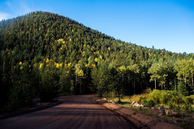 Golden aspens dot the mountainside along Gold Camp Road in Pike National Forest on Tuesday, Sept. 26, 2017. <br /> <br /> (The Gazette, Nadav Soroker)