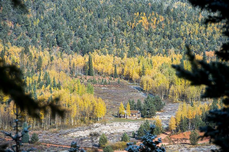 Aspens surround a cabin near the Penrose-Rosemont Reservoir in Pike National Forest on Tuesday, Sept. 26, 2017. <br /> <br /> (The Gazette, Nadav Soroker)