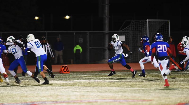 Spartan senior Julian Cooks returns the ball after a Trojan kick at Fountain-Fort Carson on Friday, Sept. 29, 2017.<br /> <br /> (The Gazette, Nadav Soroker)