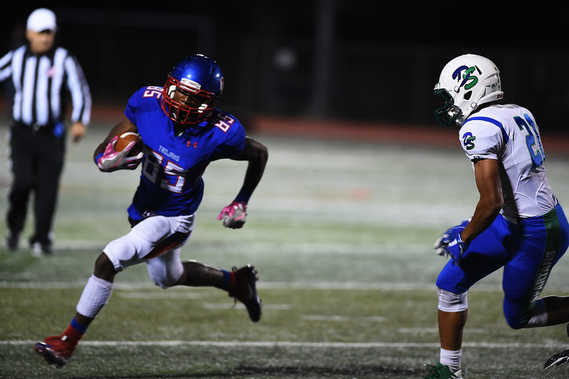 Fountain-Fort Carson senior Reggie Anthony runs wide to try and dodge Doherty Spartan Jose Handford at Fountain-Fort Carson on Friday, Sept. 29, 2017.<br /> <br /> (The Gazette, Nadav Soroker)