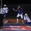 Fountain-Fort Carson senior Gabe Elliott pops up cheering after catching a touchdown pass through two Doherty Spartans at Fountain-Fort Carson on Friday, Sept. 29, 2017.<br /> <br /> (The Gazette, Nadav Soroker)