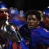 Trojan senior Erik Rolle holds a trojan helmet after intercepting a pass against the Doherty Spartans at Fountain-Fort Carson on Friday, Sept. 29, 2017. The Trojans were penalized after the play for unsportsmanlike conduct after Rolle threw the intercepted ball into the stands while celebrating.<br /> <br /> (The Gazette, Nadav Soroker)