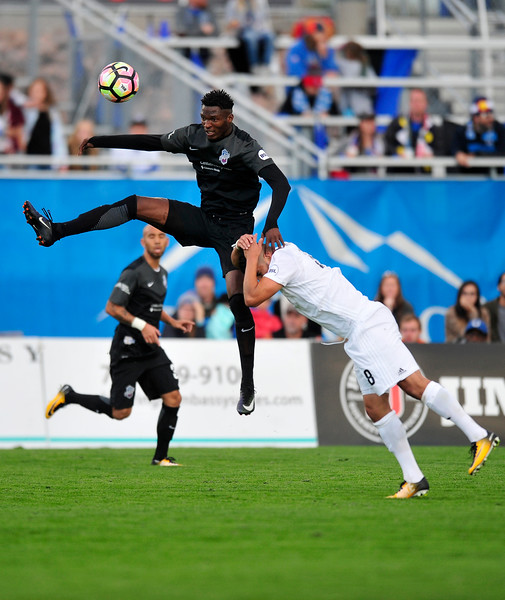 Switchback defender Pascal Eboussi leaps for the header at Wiedner Field on Saturday, Sept. 30, 2017.<br /> <br /> (The Gazette, Nadav Soroker)