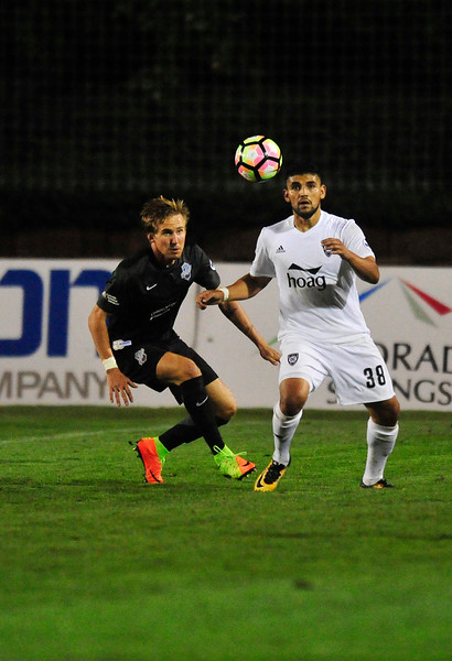 Switchback's defender Josh Phillips and Orange County forward Irvin Parra jockey for the ball at Wiedner Field on Saturday, Sept. 30, 2017. Orange County couldn't complete a comeback in the second half.<br /> <br /> (The Gazette, Nadav Soroker)