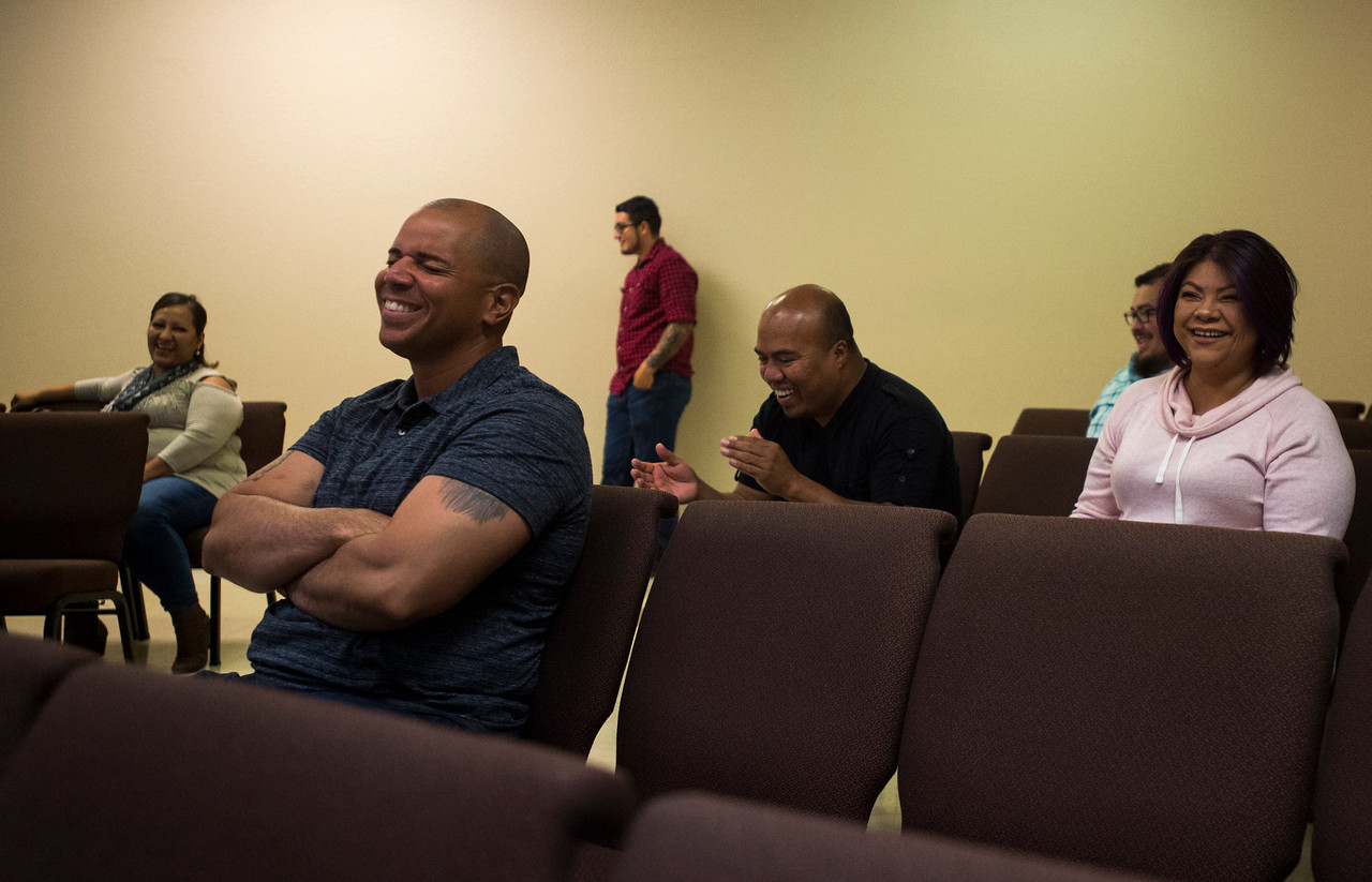 Emanuel Otero, front, laughs at Pastor Danny Garrido's joke during service at The Crossing Church in Colorado Springs, Colo. on Sunday, Sept. 17, 2017. Garrido tries to emphasize common sense and a proactive relationship with god over spirituality and holiness.<br /> <br /> (The Gazette, Nadav Soroker)