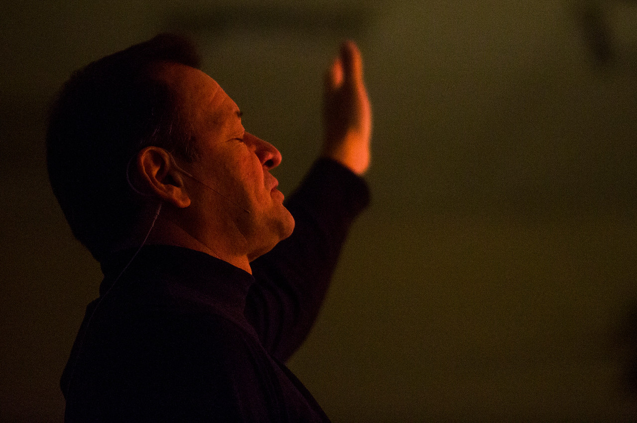 Danny Garrido raises a hand as he sings along to a worship song during the service at The Crossing Church in Colorado Springs, Colo. on Sunday, Sept. 17, 2017. The service at the church began and ended with music.<br /> <br /> (The Gazette, Nadav Soroker)