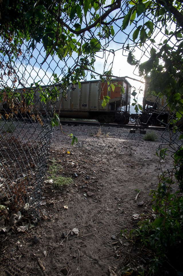 A train passes by a gap in the fence in Monument Valley Park near Bijou St. on Tuesday, Sept. 19, 2017. Four people have been killed by trains in the past three months, police believe each person was either suicidal or under the influence of drugs - or both - when they were hit by a train.<br /> <br /> (The Gazette, Nadav Soroker)