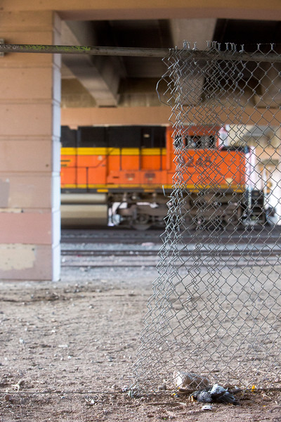 A train passes under Bijou St. near I-25, a part of the tracks where two people were fatally struck in the past three months. More people have been killed by trains during the past three months in El Paso County than in the entire decade before, officials say.<br /> <br /> (The Gazette, Nadav Soroker)