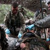 Members of the 2nd Infantry Brigade treat a mock casualty at an aid station during a training exercise at Camp Red Devil in Fort Carson, Colo. on Sunday, Sept. 24, 2017. The The casualties were picked up from near the tactical operations center in the mock town.<br /> <br /> (The Gazette, Nadav Soroker)
