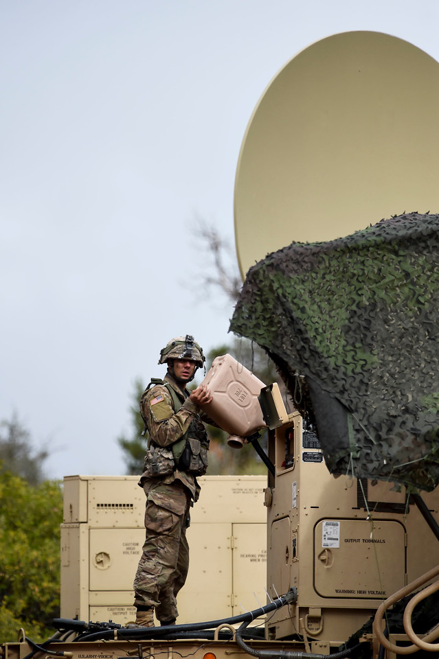 A member of the 2nd Infantry Brigade refuels equipment during a training exercise at Camp Red Devil in Fort Carson, Colo. on Sunday, Sept. 24, 2017. The exercise started Sunday, Sept. 17 and was running until all the parts of the brigade had practiced.<br /> <br /> (The Gazette, Nadav Soroker)
