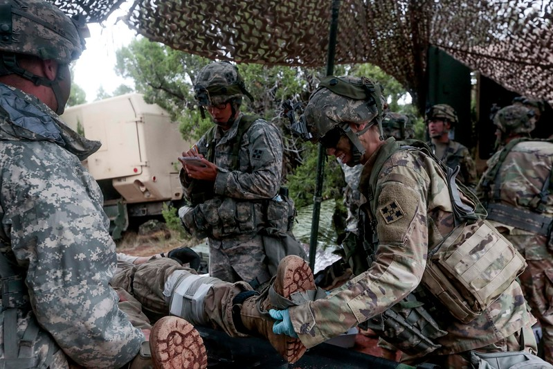 Members of the 2nd Infantry Brigade work out how to treat the casualties that came to the aid station based on the injuries reported to them in a training exercise at Camp Red Devil in Fort Carson, Colo. on Sunday, Sept. 24, 2017.  <br /> <br /> (The Gazette, Nadav Soroker)