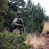 A member of the 2nd Infantry Brigade Combat Team stands watch during a training exercise at Camp Red Devil in Fort Carson, Colo. on Sunday, Sept. 24, 2017. After seizing a nearby town the brigade was focused on defending the position from members of the 1st Infantry Brigade who were their opposition.<br /> <br /> (The Gazette, Nadav Soroker)
