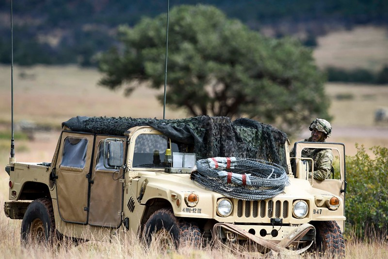 A 2nd Infantry Brigade member leans out of a humvee at Camp Red Devil in Fort Carson, Colo. on Sunday, Sept. 24, 2017. After defending part of the town the Brigades started transitioning to another part of the exercise.<br /> <br /> (The Gazette, Nadav Soroker)