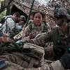 Members of the 2nd Infantry Brigade treat a mock casualty at an aid station during a training exercise at Camp Red Devil in Fort Carson, Colo. on Sunday, Sept. 24, 2017. The exercise involved training for all parts of the brigade. <br /> <br /> (The Gazette, Nadav Soroker)