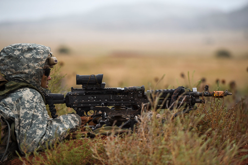 A member of the 2nd Infantry Brigade Combat Team hunkers down behind his M249 during a training exercise at Camp Red Devil in Fort Carson, Colo. on Sunday, Sept. 24, 2017. Bravo Company was assigned to part of the defensive line.<br /> (The Gazette, Nadav Soroker)