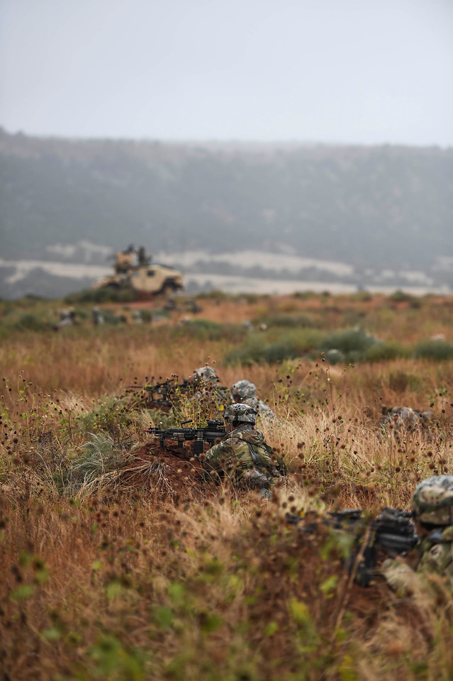Members of Bravo Company of the 2nd Infantry Brigade Combat Team wait in a defensive line west of Camp Red Devil in Fort Carson, Colo. on Sunday, Sept. 24, 2017. The Brigade was preparing for a training rotation in Fort Polk, Louisiana.<br /> (The Gazette, Nadav Soroker)