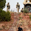 Second Infantry Brigade members watch as opposition forces surrender at Camp Red Devil in Fort Carson, Colo. on Sunday, Sept. 24, 2017. The members of 1st Brigade acting as opposition forces dressed in plain clothes for the exercise.<br /> <br /> (The Gazette, Nadav Soroker)