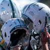 Pine Creek players hoist their helmets in celebration of their victory at Liberty High School in Colorado Springs, Colo. on Saturday, Sept. 16, 2017.<br /> <br /> (The Gazette, Nadav Soroker)