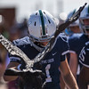 Wyatt Wieland bends his head to an eagle statue brought out to the field at Liberty High School in Colorado Springs, Colo. on Saturday, Sept. 16, 2017.<br /> <br /> (The Gazette, Nadav Soroker)