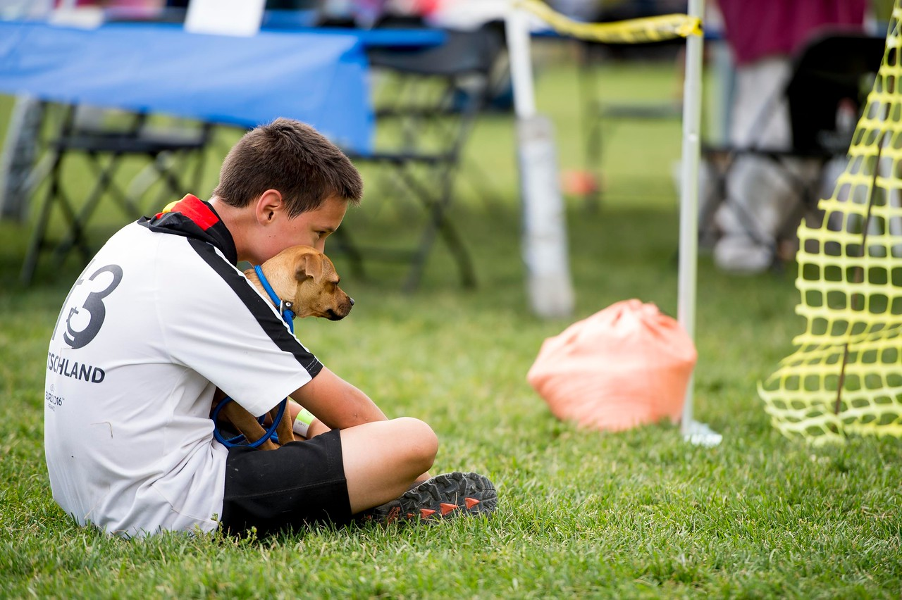 Alex Smith, 13, waits with Oliver for the rest of his family after running the opening dog walk at Pawtoberfest 2017 in Bear Creek Regional Park in Colorado Springs, Colo. on Saturday, Sept. 16, 2017. Smith's family caught up soon after.<br /> <br /> (The Gazette, Nadav Soroker)