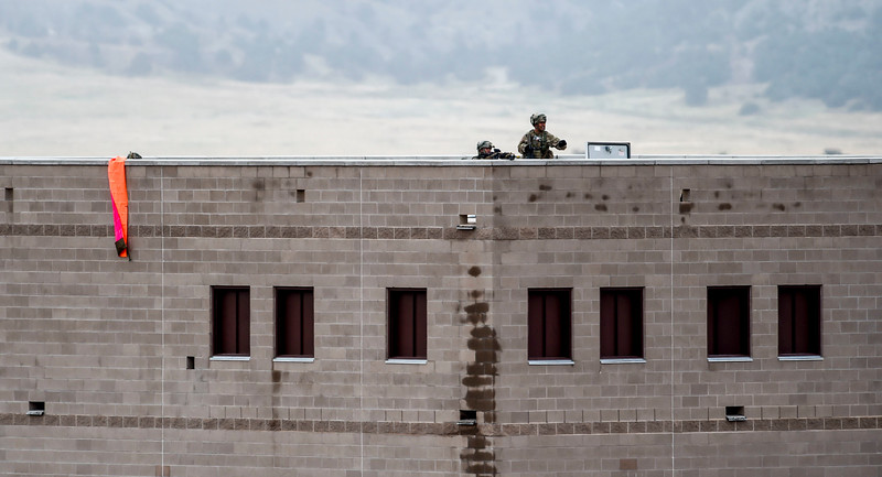 Members of the 2nd Infantry Brigade Combat Team look at approaching members of the opposition force at Camp Red Devil in Fort Carson, Colo. on Sunday, Sept. 24, 2017. 1st Brigade acted as the opposition for the training exercise.<br /> <br /> (The Gazette, Nadav Soroker)