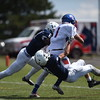 Fort Carson's Gabe Elliott drags two Pine Creek players down the field at Liberty High School in Colorado Springs, Colo. on Saturday, Sept. 16, 2017. <br /> <br /> (The Gazette, Nadav Soroker)