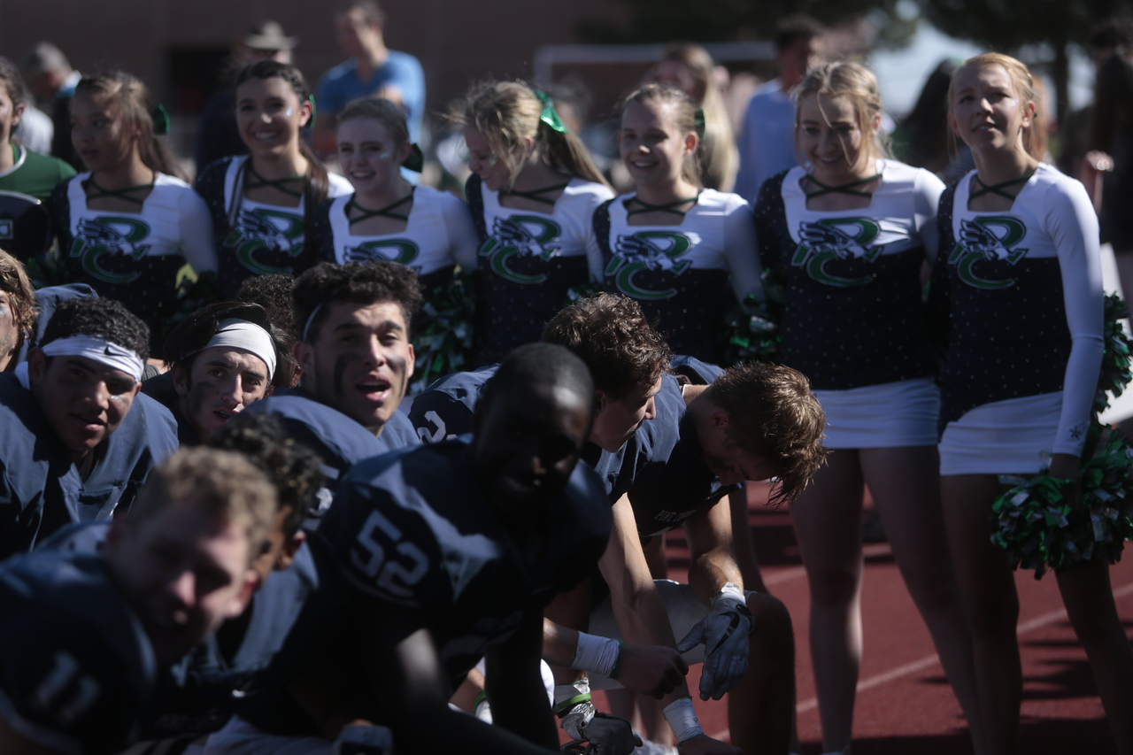 The Pine Creek Eagles huddle on the track for a chant after their victory at Liberty High School in Colorado Springs, Colo. on Saturday, Sept. 16, 2017.<br /> <br /> (The Gazette, Nadav Soroker)