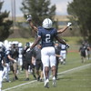 David Moore III chest bumps a teammate after running in a touchdown at Liberty High School in Colorado Springs, Colo. on Saturday, Sept. 16, 2017. Moore scored all three touchdowns for Pine Creek.<br /> <br /> (The Gazette, Nadav Soroker)