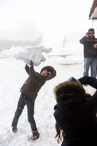 Will Wheatley, 9, throws a large chunk of snow while his sister, Emma Wheatley, and father, Paul Wheatley, take pictures at the summit of 14,115 ft. Pikes Peak on Friday, Sept. 29, 2017. The Wheatleys were on their way back to Atlanta, Ga. on the tail end of a two-week road trip.<br /> <br /> (AP Photo/The Gazette, Nadav Soroker)
