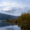 Aspens change color along the shore of the Crystal Creek Reservoir as snow caps Pikes Peak on Friday, Sept. 29, 2017.<br /> <br /> (The Gazette, Nadav Soroker)
