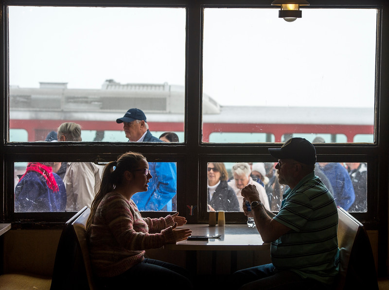 Kellie Severe and her grandfather Terry Miller warm up in the Summit House as Cog Railway riders disembark at Pikes Peak on Friday, Sept. 29, 2017. Severe and Miller came from Amarillo for vacation.<br /> <br /> (The Gazette, Nadav Soroker)