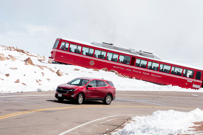 A car drives up the road to 14,115 ft. Pikes Peak while the Pikes Peak Cog Railway climbs up behind it on Friday, Sept. 29, 2017.<br /> <br /> (AP Photo/The Gazette, Nadav Soroker)