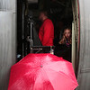 Maddie Wilson, 11, talks with her grandmother through the side door of a C-130 at the Pikes Peak Regional Airshow on Saturday, Sept. 23, 2017. Visitors who were in line for the C-130 when the rain started waited through the downpour for their chance to explore inside.<br /> (The Gazette, Nadav Soroker)