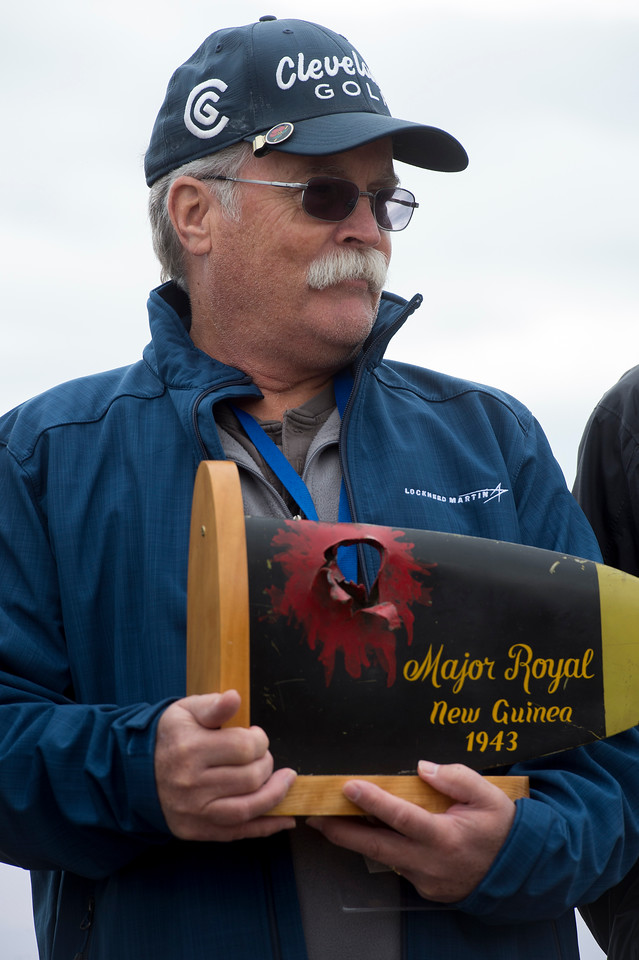 Francis Robert Royal holds the tip of a P-39 Airacobra propeller that was struck shot while his father flew it during World War II at the Pikes Peak Regional Airshow on Saturday, Sept. 23, 2017. Royal and his siblings presented the propellor and a 10,000 dollar check to the National Museum of WWII Aviation.<br /> <br /> (The Gazette, Nadav Soroker)