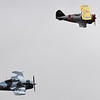 A Grumman F3F-2 Flying Barrel, top, and its successor the F4F Wildcat fly at the Pikes Peak Regional Airshow on Saturday, Sept. 23, 2017. Most of the planes that flew at the airshow on Saturday were classics, by the time the Thunderbirds were to perform rain had rolled in.<br /> <br /> (The Gazette, Nadav Soroker)