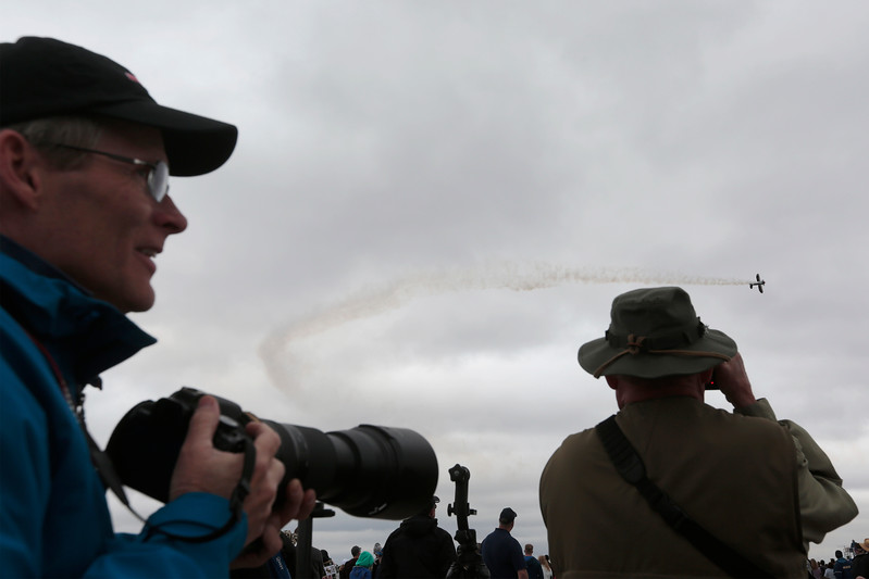 Greg Bollendonk watches Kyle Franklin pass by in Dracula at the Pikes Peak Regional Airshow on Saturday, Sept. 23, 2017. Bollendonk and his friend Larry Glass brought their cameras to photograph the planes as they flew.<br /> (The Gazette, Nadav Soroker)