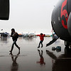 Lauri Martin and Pilot, 7, run through the rain from a C-130 on display at the Pikes Peak Regional Airshow on Saturday, Sept. 23, 2017. The C-130 crew keep the plane open for half an hour after the rain started before security had to close down the tarmac.<br /> (The Gazette, Nadav Soroker)